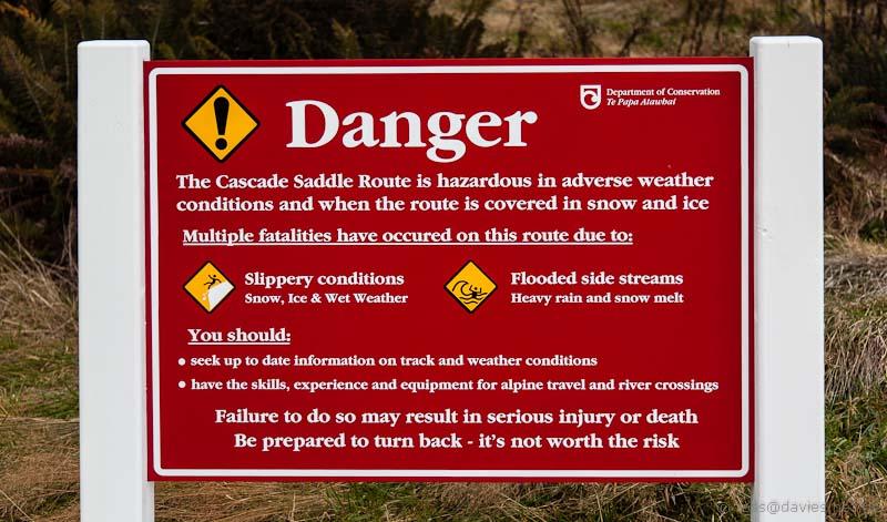 Warning sign for Cascade Saddle route West Matukituki Valley