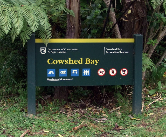 Cowshed Bay sign